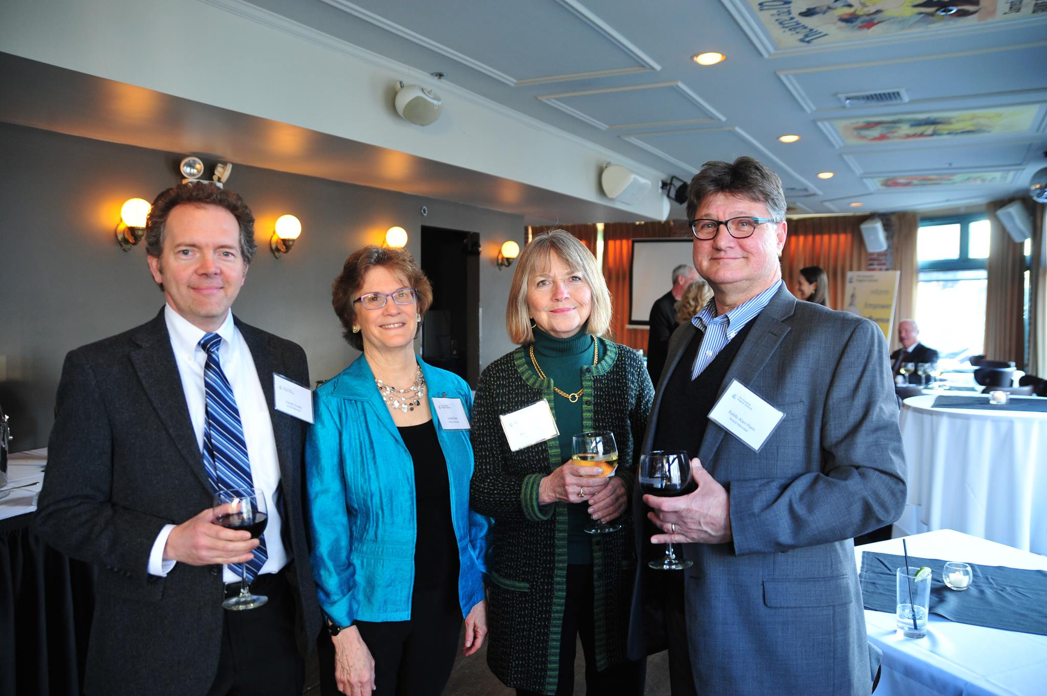 Pictured: Board members Joe Grady and Alan Flam, with Linda  Katz and Sally Strachan, past board member.
